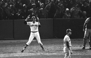 Carlton Fisk wills his hit fair as Reds pitcher Pat Darcy can only look on in disgust.