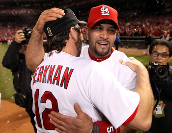 Albert Pujols and Lance Berkman embrace in celebration of their 2011 World Series Title.