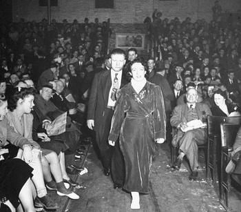 Mildred Burke with Billy Wolfe directly behind her.