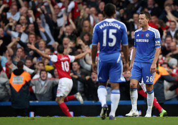 Van Persie celebrates while Terry broods