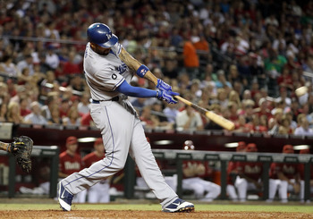 PHOENIX, AZ - SEPTEMBER 28:  Matt Kemp #27 of the Los Angeles Dodgers hits a two run home run against the Arizona Diamondbacks during the seventh inning of the Major League Baseball game at Chase Field on September 28, 2011 in Phoenix, Arizona.  (Photo by