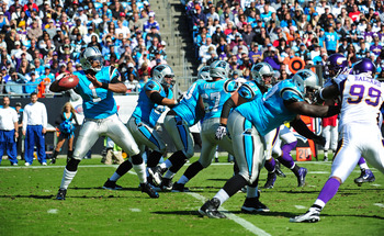 Cam Newton (1) uncorks a 39-yard touchdown pass to tight end Greg Olsen (not pictured).