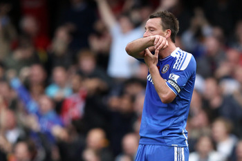 John Terry consoles himself by nippling on his forearm