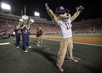 STILLWATER, OK - SEPTEMBER 8: Arizona Wildcats cheerleaders and mascot Wilbur performs during the game against the Oklahoma State Cowboys on September 8, 2011 at Boone Pickens Stadium in Stillwater, Oklahoma. Oklahoma State defeated Arizona 37-14. (Pho