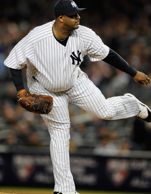 NEW YORK, NY - OCTOBER 06:  CC Sabathia #52 of the New York Yankees throws a pitch against the Detroit Tigers during Game Five of the American League Championship Series at Yankee Stadium on October 6, 2011 in the Bronx borough of New York City.  (Photo b