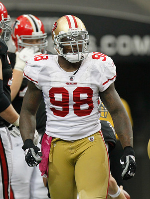 Parys haralson tries to keep aldon smith on the bench