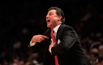 "Rick Pitino in a common pose ""listen to me."""