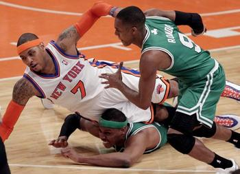 Boston-celtics-rajon-rondo-watches-new-york-knicks-carmelo-anthony-fall-on-paul-pierce-at-madison-square-garden-in-new-york_1_display_image