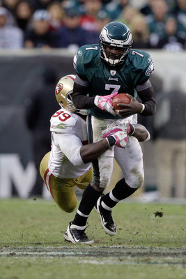 PHILADELPHIA, PA - OCTOBER 02:  Quarterback  Michael Vick #7 of the Philadelphia Eagles is sacked by Aldon Smith #99 of the San Francisco 49ers during the second half at Lincoln Financial Field on October 2, 2011 in Philadelphia, Pennsylvania.  The 49ers 