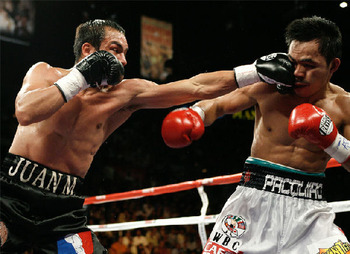 Pacquiao-hit-by-marquez_display_image