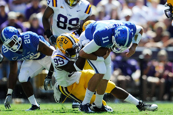 Sam Montgomery gets through for the sack against Kentucky