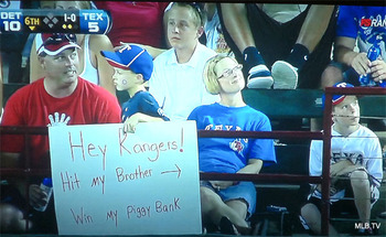 Photo_young_rangers_fan_places_bounty_on_brothers_head_display_image