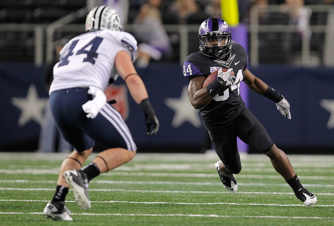 ARLINGTON, TX - OCTOBER 28:  Ed Wesley #34 of the TCU Horned Frogs runs during a game against the BYU Cougars at Cowboys Stadium on October 28, 2011 in Arlington, Texas. The TCU Horned Frogs defeated the BYU Cougars 38-28.  (Photo by Sarah Glenn/Getty Ima