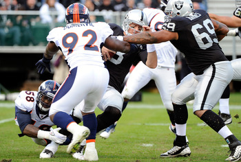 OAKLAND, CA - NOVEMBER 06:  Carson Palmer #3 of the Oakland Raiders gets sacked by Von Miller #58 and Elvis Dumervil #92 of the Denver Broncos at O.co Coliseum on November 6, 2011 in Oakland, California.  (Photo by Thearon W. Henderson/Getty Images)