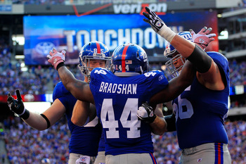 EAST RUTHERFORD, NJ - OCTOBER 16:  Ahmad Bradshaw #44 of the New York Giants celebrates a one yard touchdown with his teammates in the third quarter against the Buffalo Bills at MetLife Stadium on October 16, 2011 in East Rutherford, New Jersey.  (Photo b
