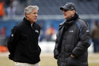 Pete Carroll (left) answers only to the big man—team owner Paul Allen (right).