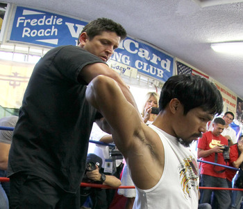 Alex Ariza helps Pacquiao get in shape.