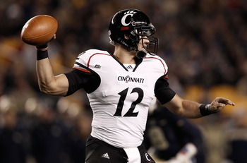 PITTSBURGH, PA - NOVEMBER 05:  Zach Collaros #12 of the Cincinnati Bearcats drops back to pass against the Pittsburgh Panthers on November 5, 2011 at Heinz Field in Pittsburgh, Pennsylvania.  (Photo by Jared Wickerham/Getty Images)