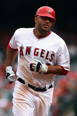 ANAHEIM, CA - SEPTEMBER 25:  Vernon Wells #10 of the Los Angeles Angels of Anaheim rounds third base after hitting a solo home run against the Oakland Athletics in the sixth inning at Angel Stadium of Anaheim on September 25, 2011 in Anaheim, California.