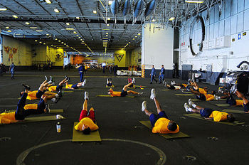 800px-us_navy_100716-n-5049h-092_personnel_department_sailors_perform_physical_training_in_the_hangar_bay_of_the_aircraft_carrier_uss_carl_vinson_cvn_70_display_image