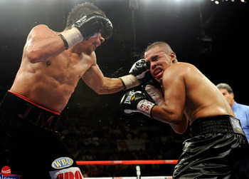 LAS VEGAS - JULY 31:  WBA/WBO lightweight champion Juan Manuel Marquez (L) hits Juan Diaz in the 11th round of their bout at the Mandalay Bay Events Center July 31, 2010 in Las Vegas, Nevada. Marquez retained his WBA and WBO lightweight championship belts