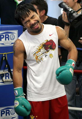 HOLLYWOOD, CA - OCTOBER 26:  Manny Pacquia laughs during a Media Workout promoting his upcoming fight with Juan Manuel Marquez at Wild Card Boxing Club on October 26, 2011 in Hollywood, California.  (Photo by Stephen Dunn/Getty Images)