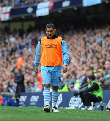 MANCHESTER, ENGLAND - SEPTEMBER 24:  Carlos Tevez of Manchester City looks on from the sidelines during the Barclays Premier League match between Manchester City and Everton at the Etihad Stadium on September 24, 2011 in Manchester, England.  (Photo by Mi