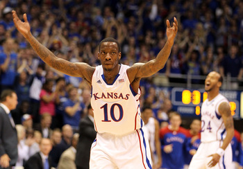 LAWRENCE, KS - NOVEMBER 11:  Tyshawn Taylor #10 of the Kansas Jayhawks reacts after scoring during the game against the Towson Tigers on November 11, 2011 at Allen Fieldhouse in Lawrence, Kansas.  (Photo by Jamie Squire/Getty Images)