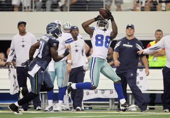 ARLINGTON, TX - NOVEMBER 06:  Wide receiver Dez Bryant #88 of the Dallas Cowboys makes a catch while being pursued by Kam Chancellor #31 of the Seattle Seahawks in the first half at Cowboys Stadium on November 6, 2011 in Arlington, Texas.  (Photo by Jeff