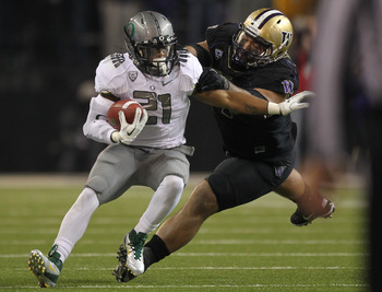 SEATTLE - NOVEMBER 05:  Running back LaMichael James #21 of the Oregon Ducks rushes against Alameda Ta'amu #74 of the Washington Huskies on November 5, 2011 at Husky Stadium in Seattle, Washington. Oregon won 34-17. (Photo by Otto Greule Jr/Getty Images)