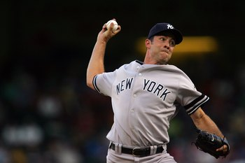 ARLINGTON, TX - AUGUST 07:  Pitcher Mike Mussina #35 of the New York Yankees throws against the Texas Rangers on August 7, 2008 at Rangers Ballpark in Arlington, Texas.  (Photo by Ronald Martinez/Getty Images)