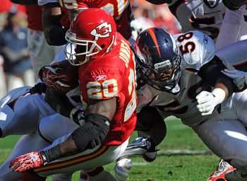 KANSAS CITY, MO - NOVEMBER 13:  Linebacker Von Miller #58 of the Denver Broncos tackles running back Thomas Jones #20 of the Kansas City Chiefs during the first half on November 13, 2011  at Arrowhead Stadium in Kansas City, Missouri.  Denver defeated Kan