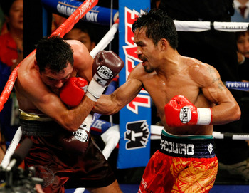 Manny Pacquiao beat De La Hoya into submission over eight lopsided rounds.
