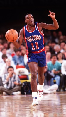 11 May 1994: DETROIT POINT GUARD ISIAH THOMAS DRIBBLES THE BALL WHILE CALLING AN OFFENSE DURING THE PISTONS GAME AT THE DENVER NUGGETS.