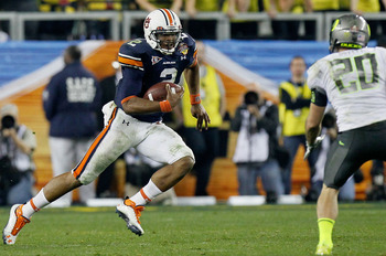 Cam Newton (2) used his legs and his arm to lead the Auburn Tigers to a 23-20 victory over the Oregon Ducks in the 2011 BCS National Championship.