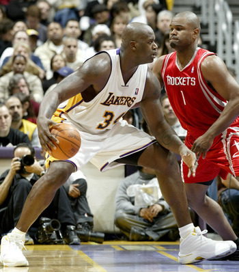 Alton Ford trying to hold his ground against Shaquille O'Neal.