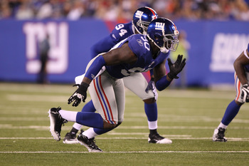EAST RUTHERFORD, NJ - AUGUST 22: Jason Pierre-Paul #90 of the New York Giants in action during their pre season game on August 22, 2011 at The New Meadowlands Stadium in East Rutherford, New Jersey.  (Photo by Al Bello/Getty Images)