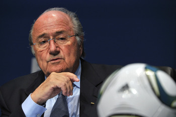 It appears that in this picture, someone came to Sepp Blatter on the day of his daughter's wedding. Its OK though, he's Swiss not Sicilian.