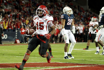 TUCSON, AZ - NOVEMBER 05:  Runningback John White IV #15 of the Utah Utes scores a 11 yard rushing touchdown against the Arizona Wildcats during the college football game at Arizona Stadium on November 5, 2011 in Tucson, Arizona.  The Utes defeated the Wi