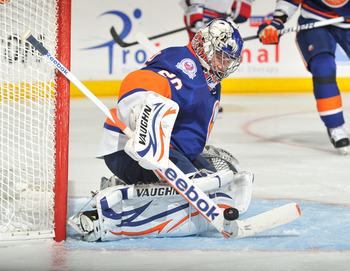 UNIONDALE, NY - NOVEMBER 15: Evgeni Nabokov #20 of the New York Islanders makes a stick save during the third period against the New York Rangers at Nassau Coliseum on November 15, 2011 in Uniondale, New York. (Photo by Christopher Pasatieri/Getty Images)