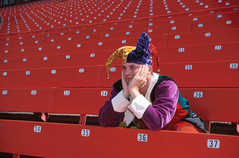Bored-jester-in-empty-stadium-uid_display_image