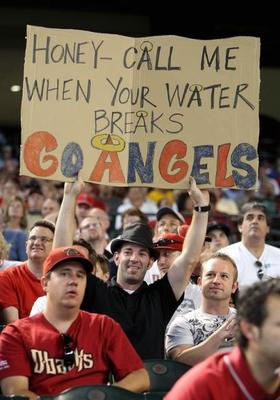 Sports-fan-signs-pregnant-wife_display_image