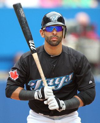 TORONTO, CANADA - AUGUST 14:  Jose Bautista #19 of the Toronto Blue Jays bats in a MLB game against the Los Angeles Angels of Anaheim on August 14, 2011 at the Rogers Centre in Toronto, Canada. The Jays defeated the Angels 5-4 in extra innings. (Photo by