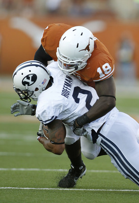 AUSTIN, TX - SEPTEMBER 10: Linebacker Emmanuel Acho #18 of  the Texas Longhorns tackles wide receiver Cody Hoffman #2 of the BYU Cougars on September 10, 2011 at Darrell K. Royal-Texas Memorial Stadium in Austin, Texas.  Texas defeated BYU 17-16. (Photo b