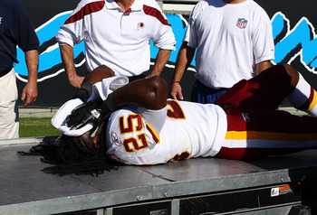 CHARLOTTE, NC - OCTOBER 23:  Tim Hightower #25 of the Washington Redskins gets attention by the training staff after being injured in the second half of the game with the Carolina Panthers at Bank of America Stadium on October 23, 2011 in Charlotte, North