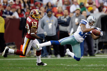 LANDOVER, MD - NOVEMBER 20: Orlando Scandrick #32 of the Dallas Cowboys intercepts a pass intended for Anthony Armstrong #13 of the Washington Redskins during the second half at FedExField on November 20, 2011 in Landover, Maryland.  (Photo by Rob Carr/Ge