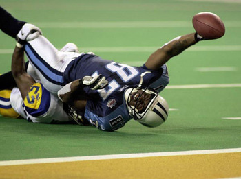 Kevin Dyson reaching for the goal line. He was tackled 1 yard short as time expired in Super Bowl XXXIV to give the Rams their first Super Bowl Championship.