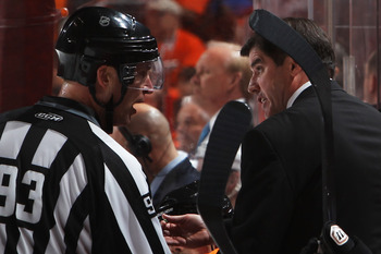 Lavy explaining hockey to a zebra