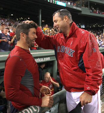 Wakefield (right) celebrated with batterymate Varitek after earning his 200th win last summer.