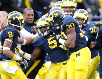 ANN ARBOR, MI - NOVEMBER 26:  Courtney Avery #5 of the Michigan Wolverines celebrates a late fourth quarter interception to beat Ohio State Buckeyes 40-34 with J.T. Floyd #8 at Michigan Stadium on November 26, 2011 in Ann Arbor, Michigan. (Photo by Gregor